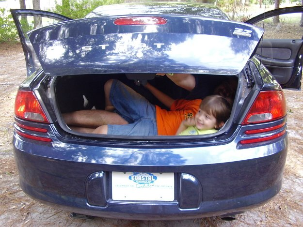 Smart parent demonstrates glow-in-the-dark trunk release