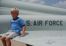Noah sitting on the wing of a air plane2