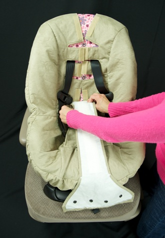 Womans arms holding car seat strap