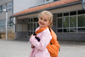 happy child returning to safer school