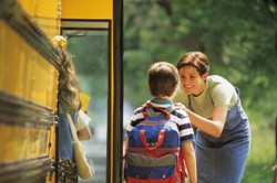 boy getting on back-to-school bus
