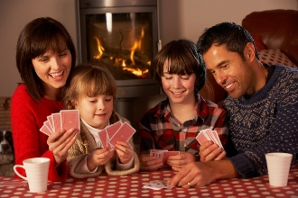 Family game of cards by the fire