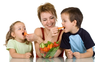 Mother Feeding Kids With Vegetables