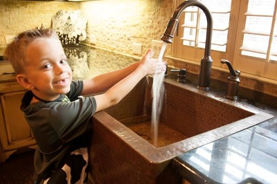 boy washing hands at sink