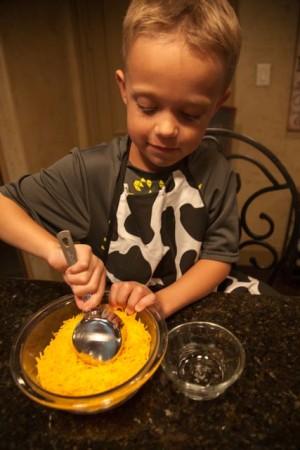 boy measuring cheese