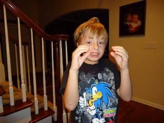 child making stimming motions