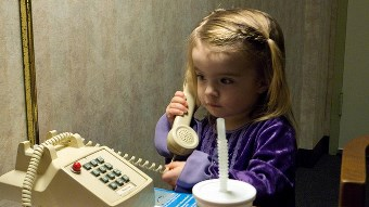 little girl practice calling 911