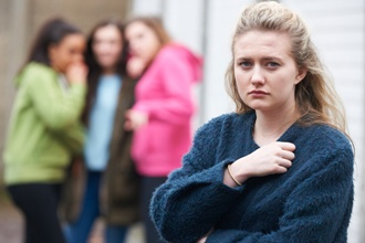 Unhappy Teenage Girl Being Talked About By Peers