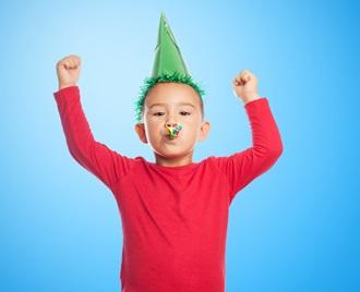 Boy celebrating new year's eve