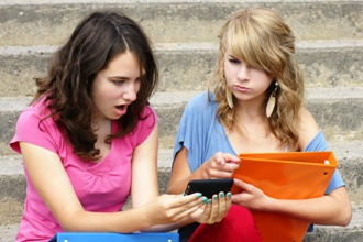 two girls looking at mobile phone