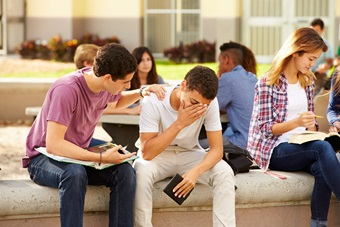 Male High School Student Comforting Unhappy Friend