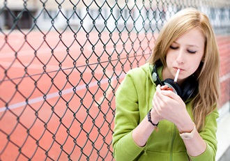 Teen-girl-smoker-lighting-up